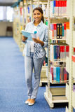 University student library. Portrait of female university student in library royalty free stock images