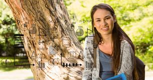University student with math equations in campus. Digital composite of University student with math equations in campus royalty free stock images