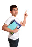 University Student Pointing his finger. A university or college student carrying some books and pointing to your message Royalty Free Stock Photography