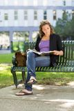 University Student Reading Book On Bench Royalty Free Stock Photo
