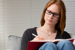 University Student Reading at Home Stock Images