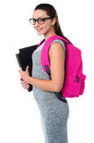 University student ready to attend college. College girl posing with backpack and files stock photography