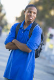 University student with rucksack outside. Male university student off campus Stock Photos