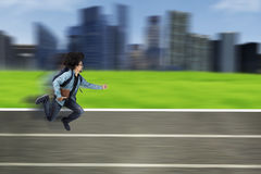 University student running on track with book Stock Image