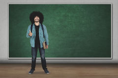 University student showing ok gesture in classroom Royalty Free Stock Image