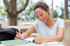 University student studying examination. Pretty african university student studying for examination Royalty Free Stock Photography