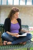 University Student Studying While Sitting On Bench Royalty Free Stock Photo