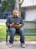 University Student Using Digital Tablet At Campus. Full length of male university student using digital tablet at campus Royalty Free Stock Image