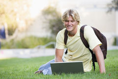 University student using laptop outside stock image
