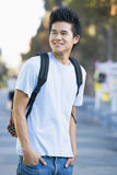 University student wearing rucksack Stock Images