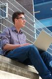 University student working on laptop outdoors Stock Photography