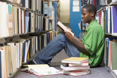 University student working in library Royalty Free Stock Photo