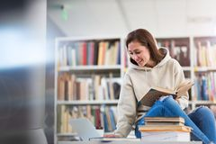 Young female student studying in the library Royalty Free Stock Photography