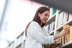Young female student studying in the library Stock Photo