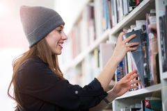 Young female student studying in the library Stock Photography