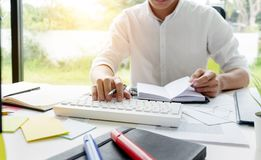 University student working in library with homework after study class.  royalty free stock images