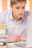 University student writing paper work. Royalty Free Stock Images