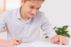 University student writing paper work. Stock Photography