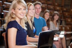 University Students. Group of students looking at camera in a university lecture hall Stock Photography