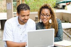 University students. Two african university students study computer laptop together outdoors Royalty Free Stock Photography