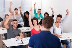 University students answering teacher stock photography