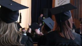 University students applauding to congratulate senior professor on retirement. Stock footage stock video