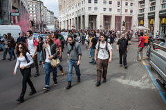 University students during a demonstration in Milan. MILAN, ITALY - MAY 7, 2013: University students marching in the streets to protest against the evacuation of Royalty Free Stock Photography
