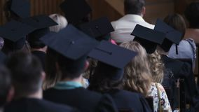 University students and parents watching official graduation ceremony, education. Stock footage stock footage