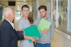 University students reading book before class. Student Royalty Free Stock Photography