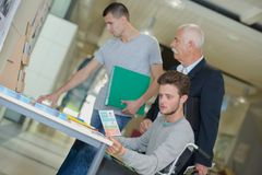 University students reading brochures at entrance. University students reading the brochures at the entrance Royalty Free Stock Photography