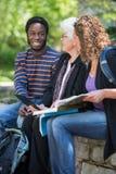 University Students Sitting with Professor Stock Photo