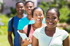 University students standing. Group of beautiful african university students standing in a row Royalty Free Stock Images