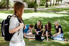 University Students Study Group. A group of university students stuying together with one student in foreground Royalty Free Stock Photos