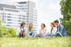 University students studying together on campus ground Stock Photos