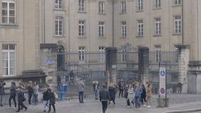 University students talking and having rest near academic building, slow motion. Stock footage stock video