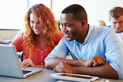 University Students Using Digital Tablet And Laptop In Class Royalty Free Stock Photos
