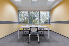 University study room with window. White furniture and yellow wall Stock Photography