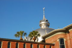 University Tampa Florida. Single minaret with against a royal blue sky at the University of Tampa in the City of Tampa with two palm trees Royalty Free Stock Photos