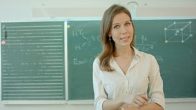 University teacher talking into the camera. Professional shot on BMCC RAW with high dynamic range. You can use it e.g in your commercial video, school, college stock footage