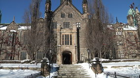 The University of Toronto, Trinity college. The University of Toronto was designed by Frederick William Cumberland stock video