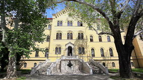 University of Zagreb. ZAGREB, CROATIA - MAY 2: Main building of the University of Zagreb in the city center with History of Croats sculpture at the entrance on stock video