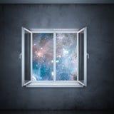 Universum i fönstret (beståndsdelar som möbleras av NASA) Royaltyfria Foton