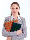 Uniwersyteckie dziewczyny mienia książki obrazy stock
