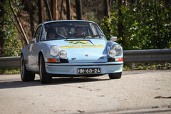 Unknow Treiber treibt Porsche 911 an Stockbild