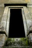 Into the unknown. Looking up into the blackness beyond an open gothic stone doorway stock photos