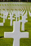 Unknown American Soldier's Grave, Italy. Field of crosses in the Florence American Cemetery and Memorial in Italy serves as a background to the cross marking the Royalty Free Stock Photo