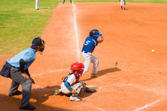 Unknown batter hitting the ball Royalty Free Stock Photos