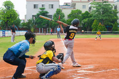 Unknown batter hitting the ball Stock Photo