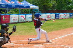 Unknown batter hitting the ball Stock Image