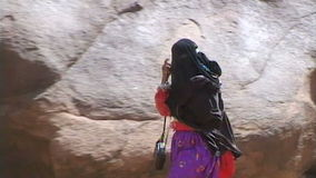 Unknown Bedouin girl. Bedouin shepherdess at the foot of Mount Sinai stock footage